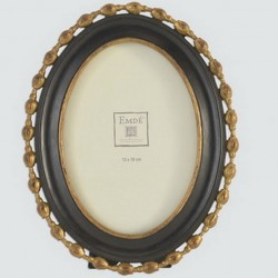 Black and gold ornate oval frame