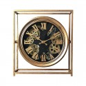 Mechanical clock in gold color with visible gears